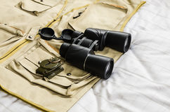 Compass and binoculars on safari suit Stock Image