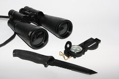 Compass, binokulars. Tubular compass, binoculars and blackened knife isolated on a white background Stock Image