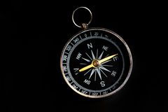 Compass on black Stock Images