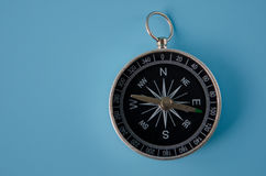 Compass on a blue background Royalty Free Stock Photo