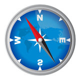 Compass with blue globe background Stock Images