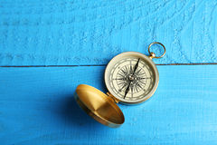 Compass on blue wooden background Royalty Free Stock Image