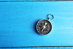 Compass on the blue wooden background Royalty Free Stock Images