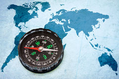 Compass on the blue world map. Stock Photo