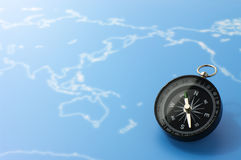 Compass on blue world map. Royalty Free Stock Photography