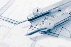 Compass on blueprint. Compass on a blueprint, close up Stock Image