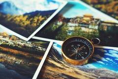 Compass on blur photograph of popular tourist destination background, traveling destination plan concept. Copy space stock photos