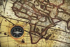 Compass on blur vintage map background, retro color tone, direction journey planning concept, blank space, top view. Copy space royalty free stock images