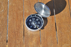 The compass on boards. Stock Photo