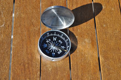 Compass on the boards. Stock Images