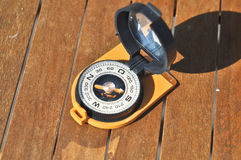 Compass on the boards. Royalty Free Stock Photography