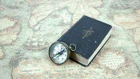 A compass and a book on a map stock video footage