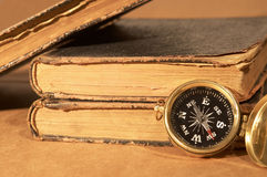 Compass and books Stock Photos