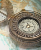 Compass. Brass antique compass on globe Royalty Free Stock Image