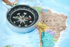 Compass with Brazil world map background. Compass with Brazil globe world map background close up royalty free stock photo
