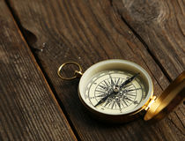 Compass on brown wooden background Stock Images