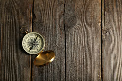 Compass on brown wooden background Stock Photography