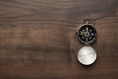 Compass on the brown wooden table Stock Image