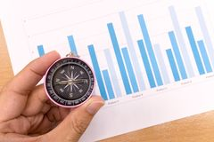 Compass and Business graphs,. Finance Concept Royalty Free Stock Images