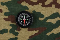 Compass on a camouflage. Background royalty free stock photos