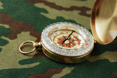Compass on a camouflage Royalty Free Stock Photography