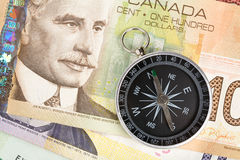Compass and canadian dollar Royalty Free Stock Images