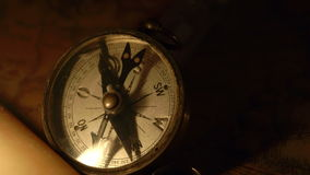 A compass and the candle on the map stock video