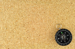 Compass on with a canvas of Plywood. Background royalty free stock images