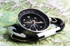 Compass and carabiner Stock Photo