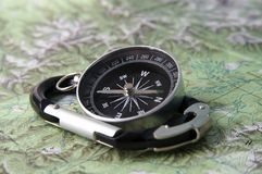 Compass and carabiner. Black compass and black carabiner Stock Photo