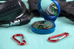 Compass, carabiners, gloves and Bicycle lock. Side view.  royalty free stock photography