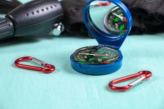 Compass, carabiners, gloves and Bicycle lock. Side view.  royalty free stock images