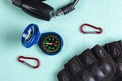Compass, carabiners, gloves and Bicycle lock. Top view.  stock photos