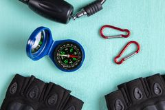Compass, carabiners, gloves and Bicycle lock. Top view.  royalty free stock images