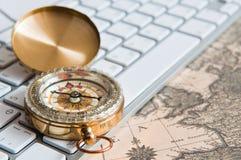 Compass on a card Royalty Free Stock Photos