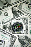 Compass on cash Stock Images