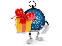 Compass character holding gift Royalty Free Stock Photography