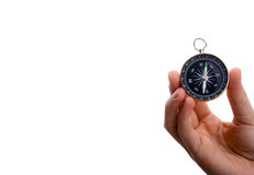 Compass in child's hand. Isolated compass in child's hand  on a white background Stock Photography