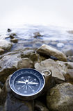 Compass on cobbles royalty free stock image