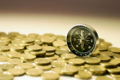 Compass on Coins. In Warm Tone Royalty Free Stock Images
