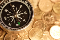 Compass and coins Royalty Free Stock Image
