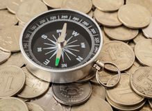 Compass on a coins Royalty Free Stock Image