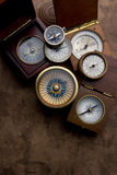 Compass collection. A group of antique compasses on a weathered paper background Stock Photo