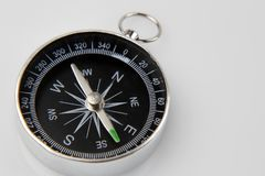 Compass. Closeup on plain background Royalty Free Stock Photos