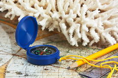 Compass and coral Stock Photos