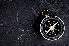 Compass on dark background concept - direction motion top view Stock Photography