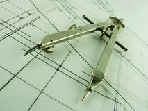 Compass & Design. Drawing compass sitting on engineering beam design drawings Stock Photos