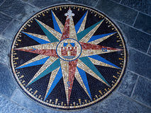 Compass directions wind rose. Beautiful compass directions wind rose made from colorful mosaic stones Royalty Free Stock Images