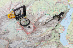 Compass and divider caliper on a hiking map Royalty Free Stock Photo