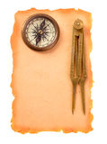 Compass and divider on paper Royalty Free Stock Photos